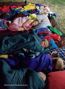 backyard campout, sleeping in the backyard, sleeping under the stars, kids in sleeping bags