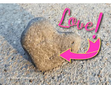 Heart-shaped rock with the word Love and an arrow pointing from word to rock. grandchild penpal sent a rock in mail