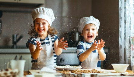 Boy and girl baking in kitchen, happy kids in chef hats, cooking subscription boxes for kids, Adventures in NanaLand