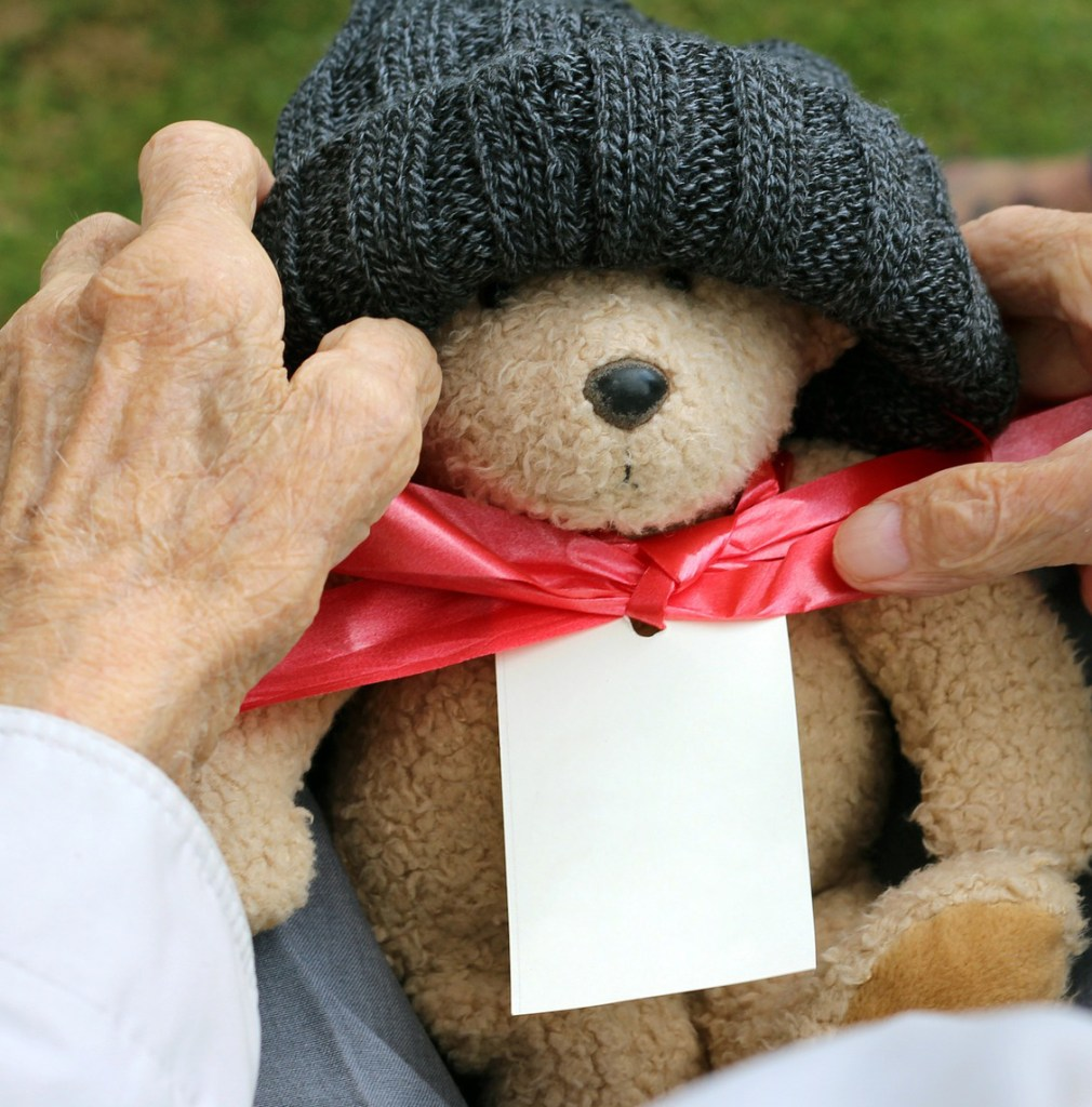 teddy bear being held by elderly hands - Adventures in NanaLand