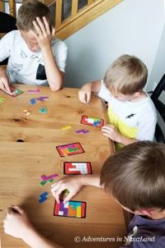 Kids playing a board game - Best Games for Families to Play Together - Adventures in NanaLand