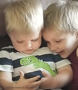Little boys looking at cell phone - Living far away from grandchildren - Adventures in NanaLand