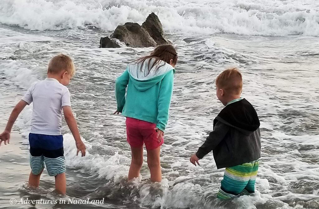 Children playing in the water at the beach - Beating the Disneyland Crowds - Adventures in NanaLand
