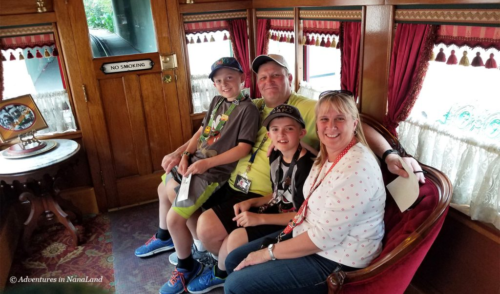 Grandparents and grandchildren in the Lilly Belle Car of the Disneyland Railroad Train - Beating the Disneyland Crowds - Adventures in NanaLand