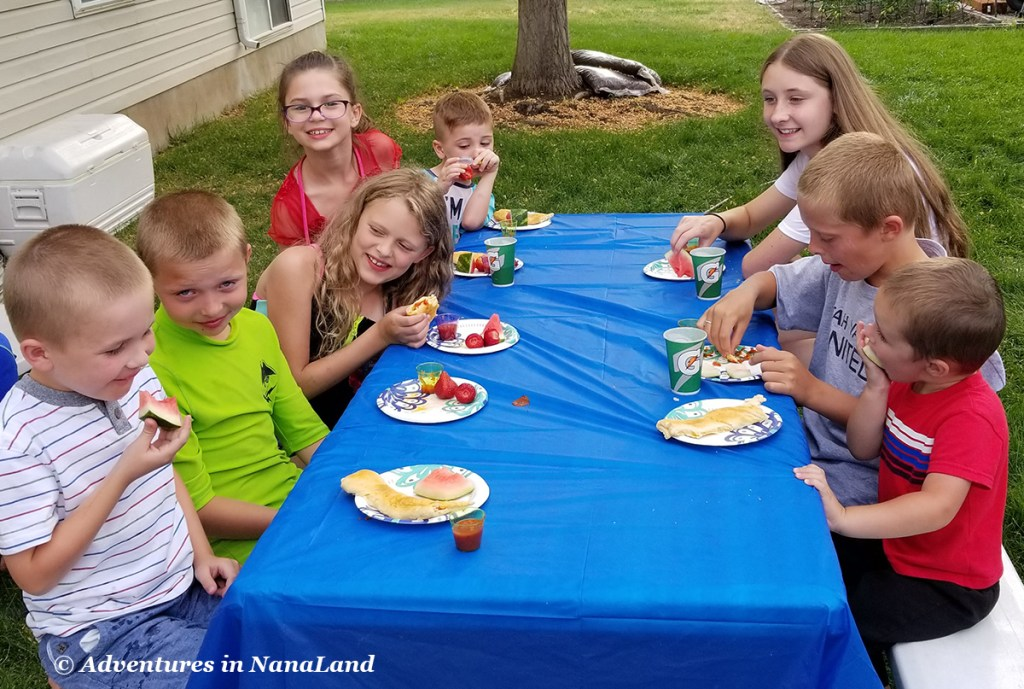 Kids sitting at a picnic table eating - Kid friendly meals - Adventures in NanaLand