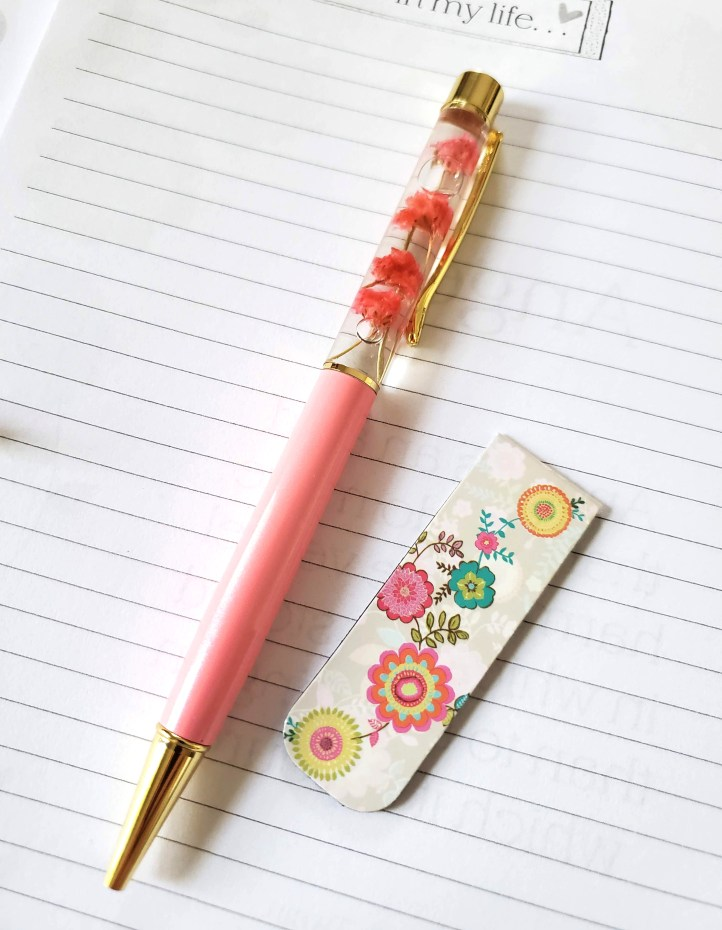 Floral pen with bookmark on blank lined journal page - Write Your Story - Adventures in NanaLand