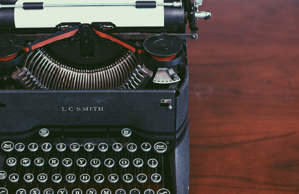 Old-fashioned typewriter on wooden desk - Writing a life story - Adventures in NanaLand