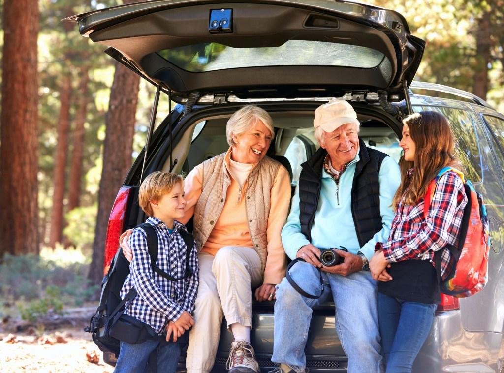 Grandparents and grandchildren sitting in back of van before hiking - What is Grandma Camp - Adventures in NanaLand