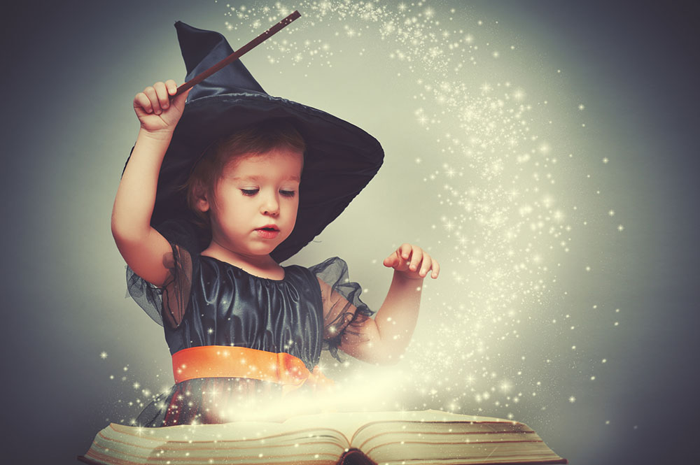 Little girl in witch Halloween costume - Halloween Care Package for Grandkids - Adventures in NanaLand