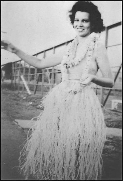 Jane in hula skirt