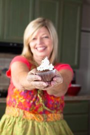 cheri liefeld holding a cupcake