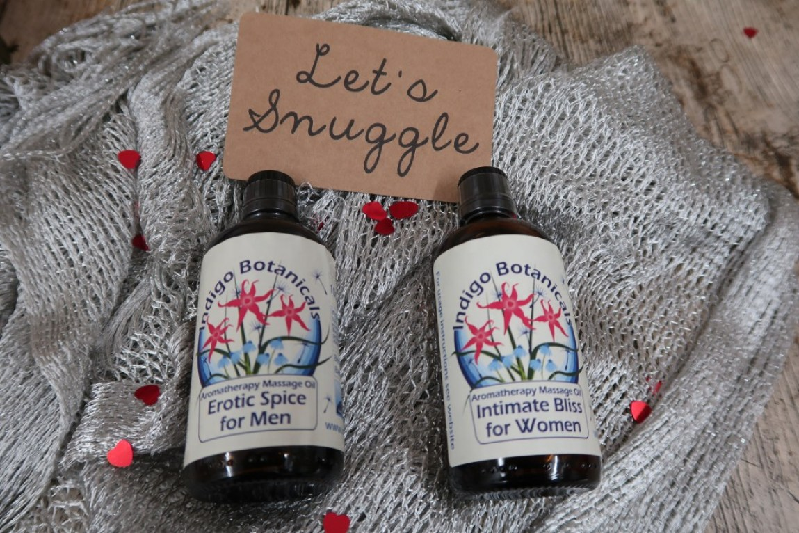 two massage oils on a blanket