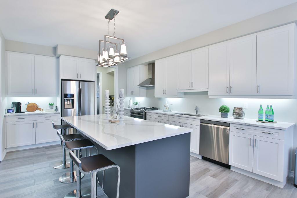 modern white kitchen with breakfast island