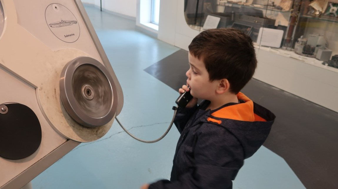young boy listening to the captains orders at the uboat story liverpool