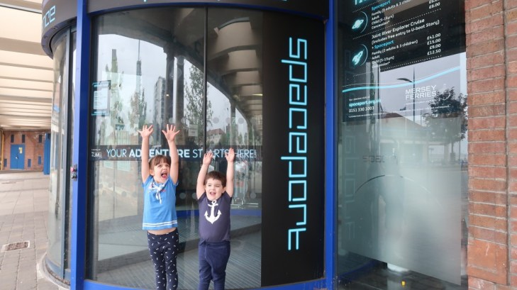 exited children at the entrance to Spaceport