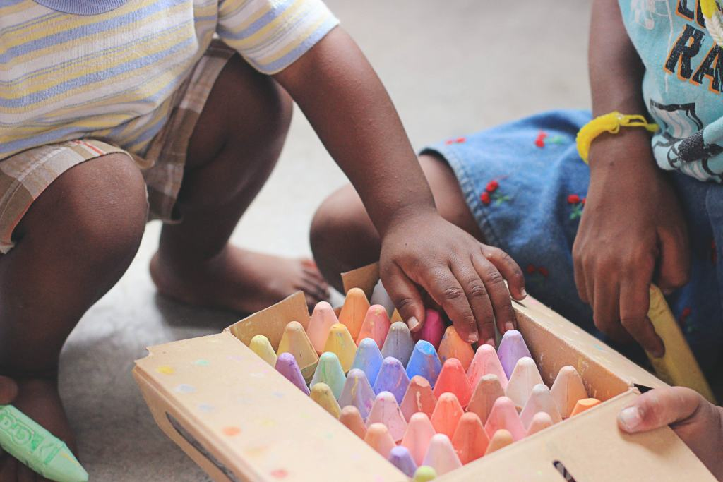 kids with colorful chalks