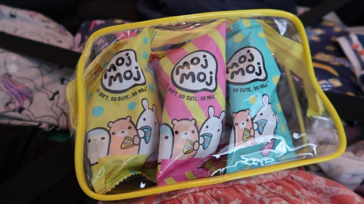 close up of 3 moj moj packs in clear plastic carrier
