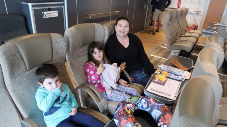 family seated in ocean club lounge The Condor Liberation condor ferries