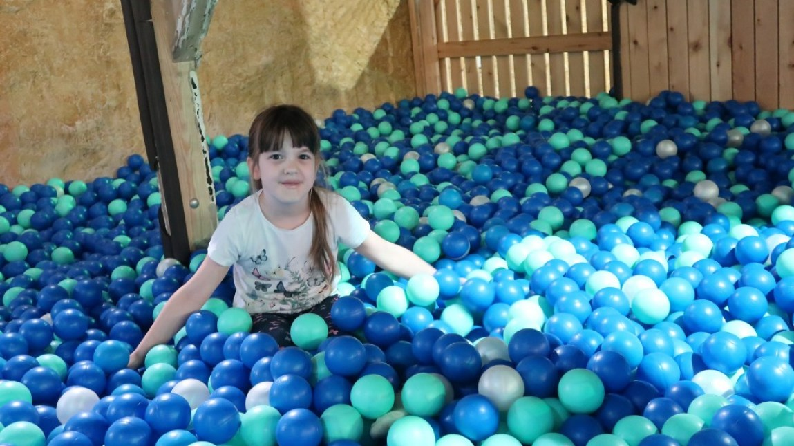 girl sitting in ball pool Tamba Park Jersey