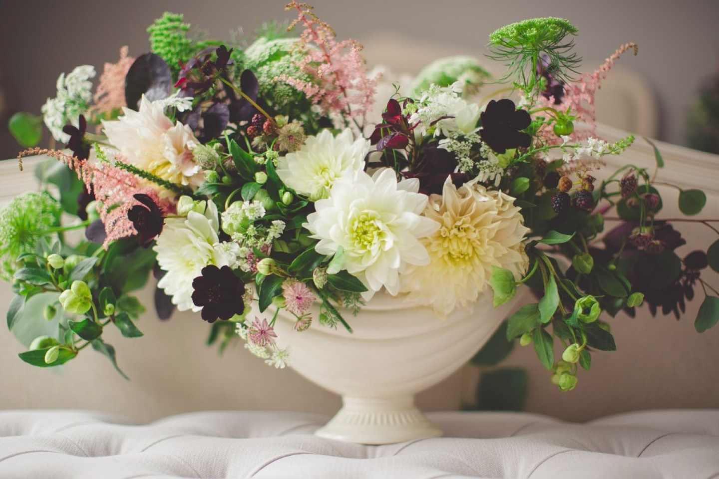 bunch of mixed flowers in a white vase