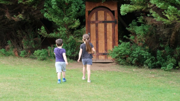 children approaching magical forest door at jersey zoo