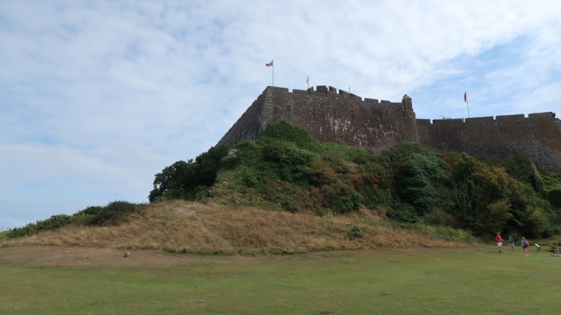 looking up at Mont Orgueil Castle walls