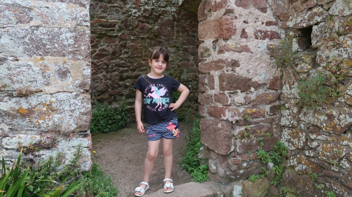 girl striking a pose at Mont Orgueil Castle Jersey