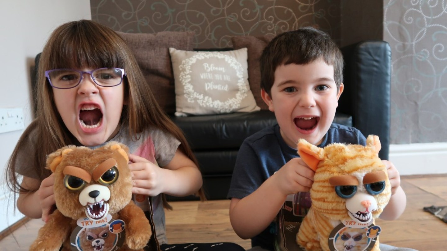 kids making fierce faces with feisty pets