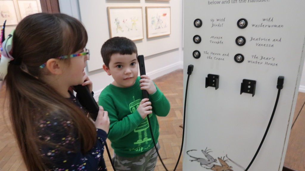 kids on a telephone in art gallery