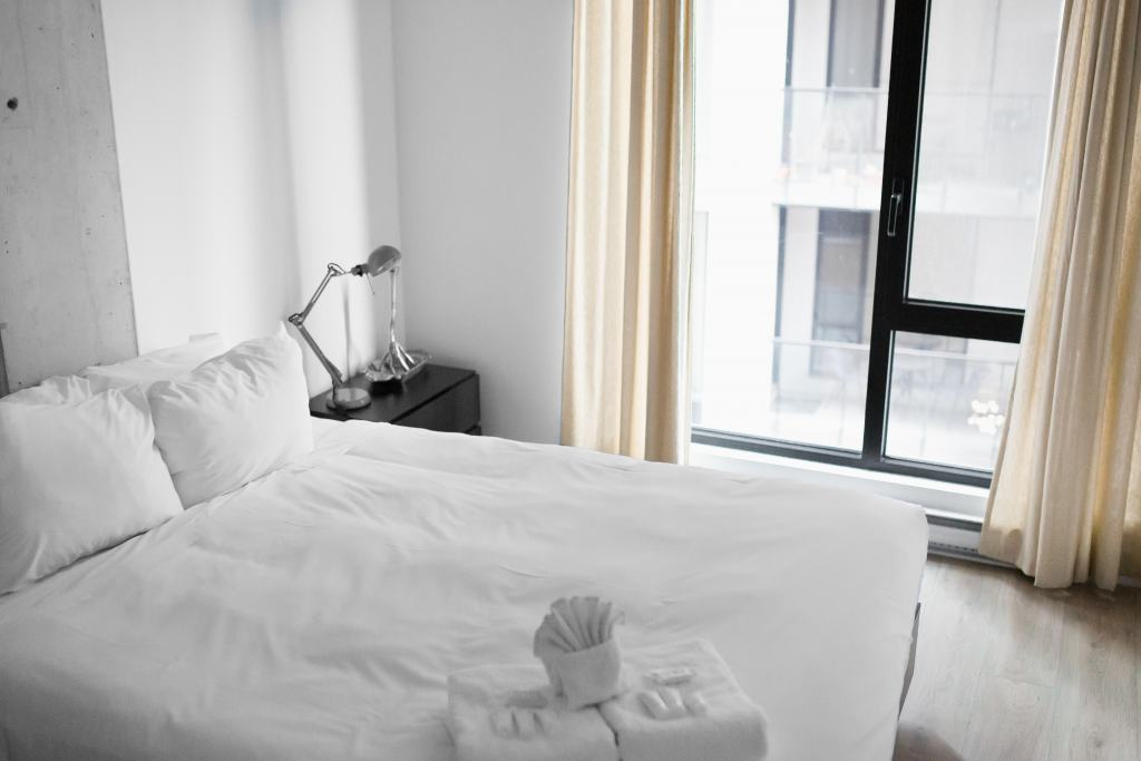 hotel bedroom bed and window white linen