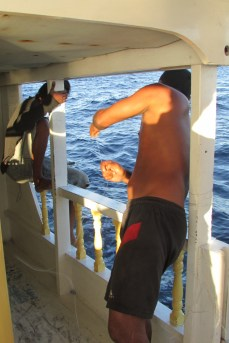 Fishing over the side of the boat