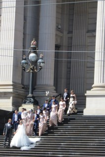 It's a nice day for a white wedding - on the steps of City Hall.