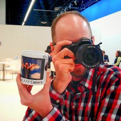 Me with my Samsung NX20 and a mug of me as an angel using the camera