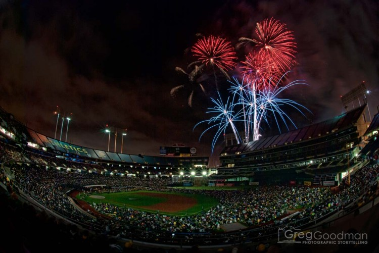 Fireworks boom above the O.co Coliseum after an Oakland A's baseball game.