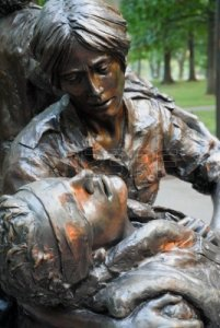 3552142-bronze-statue-of-female-nurse-caring-for-wounded-solider-near-the-vietnam-memorial-on-the-national-m