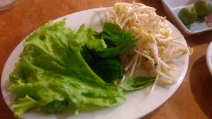 A bowl of Pho comes with romaine lettuce, basil and bean sprouts