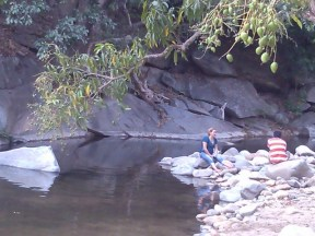 Relaxing at the river at the base of Tehaucalco, Mexico