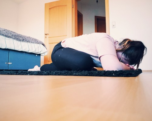 girl in pigeon yoga pose during yoga with adriene practice
