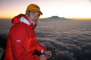 Dean on Mt. Meru, Tanzania (Kilimanjaro in background)