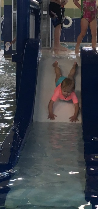 Sliding down head first at the Longmont Rec Center Pool