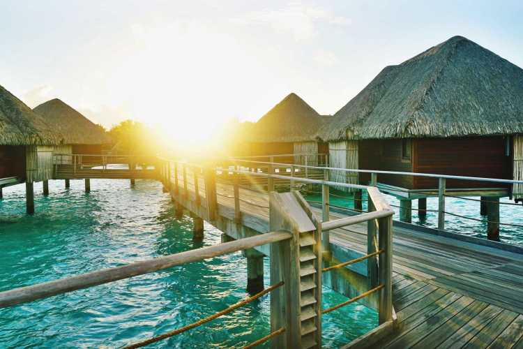 An exotic destination vacation to Bora Bora staying in luxurious over-water bungalows