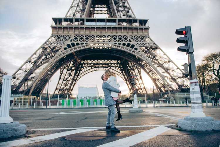 An iconic moment in an iconic location on a romantic destination vacation in Paris, France