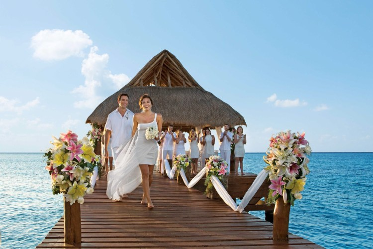 A destination wedding over-the-water chapel at an all inclusive Secrets resort