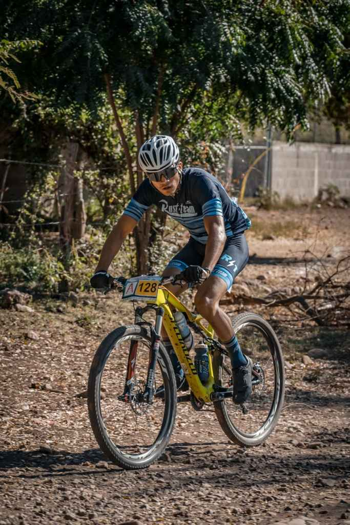 man in blue and black shirt riding on bicycle