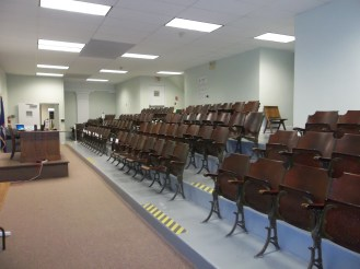 This room is the Village Court Room. Those seats are original theater seats from when this section of the Civic Center Complex was an auditorium.