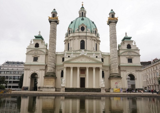 This is the Karlskirche, which was constructed from 1716 - 1739. It was the last work of architect Johann Bernhard Fischer von Erlach. His son, Joseph Emanuel finished it.