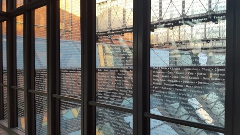 This is one of the glass walkways in the museum. The names on the glass are all of the communities that were impacted by the Holocaust. There is another glass walkway with the names of all of the victims.