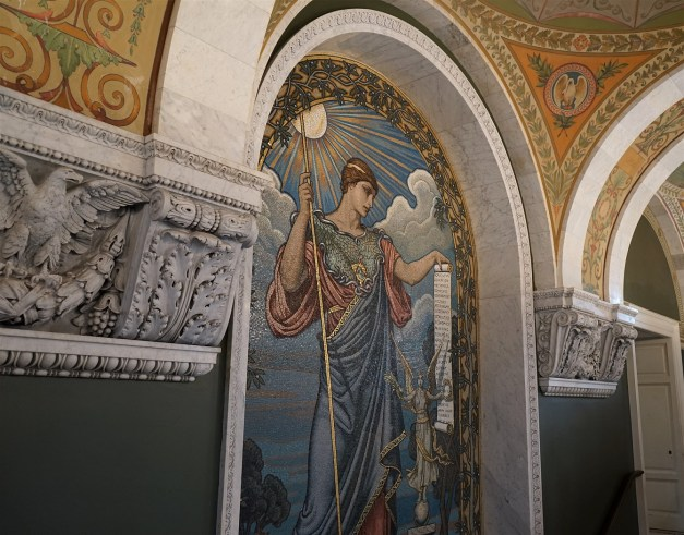 This is the Minerva mural seen on the second floor. It is right outside of the gallery that visitors can enter to view the Main Reading Room. The mural was created by Elihu Vedder.