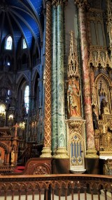 A view of right side altar: The Blessed Virgin or also called the Altar of the Immaculate Conception; it was completed in 1885. In this photo you can see some of the narrow columns that are in the Basilica, they are all decoratively painted to look like stone. The statue seen here is of St. Anne holding Mary as a child.
