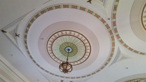 This is in the auditorium of St. Vincent's Hall. It's called a medallion and is a type of ornamentation seen on ceilings.